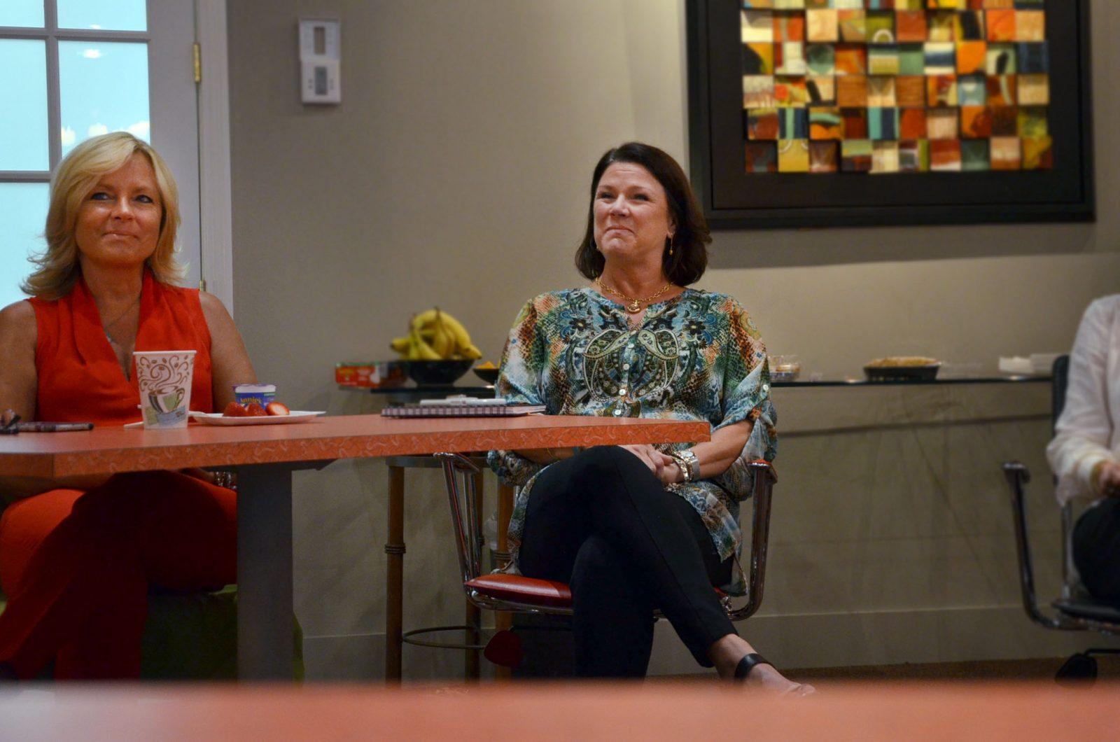Realtors Sheri Putman, left, and Lisa Albertson listen to the discussion,