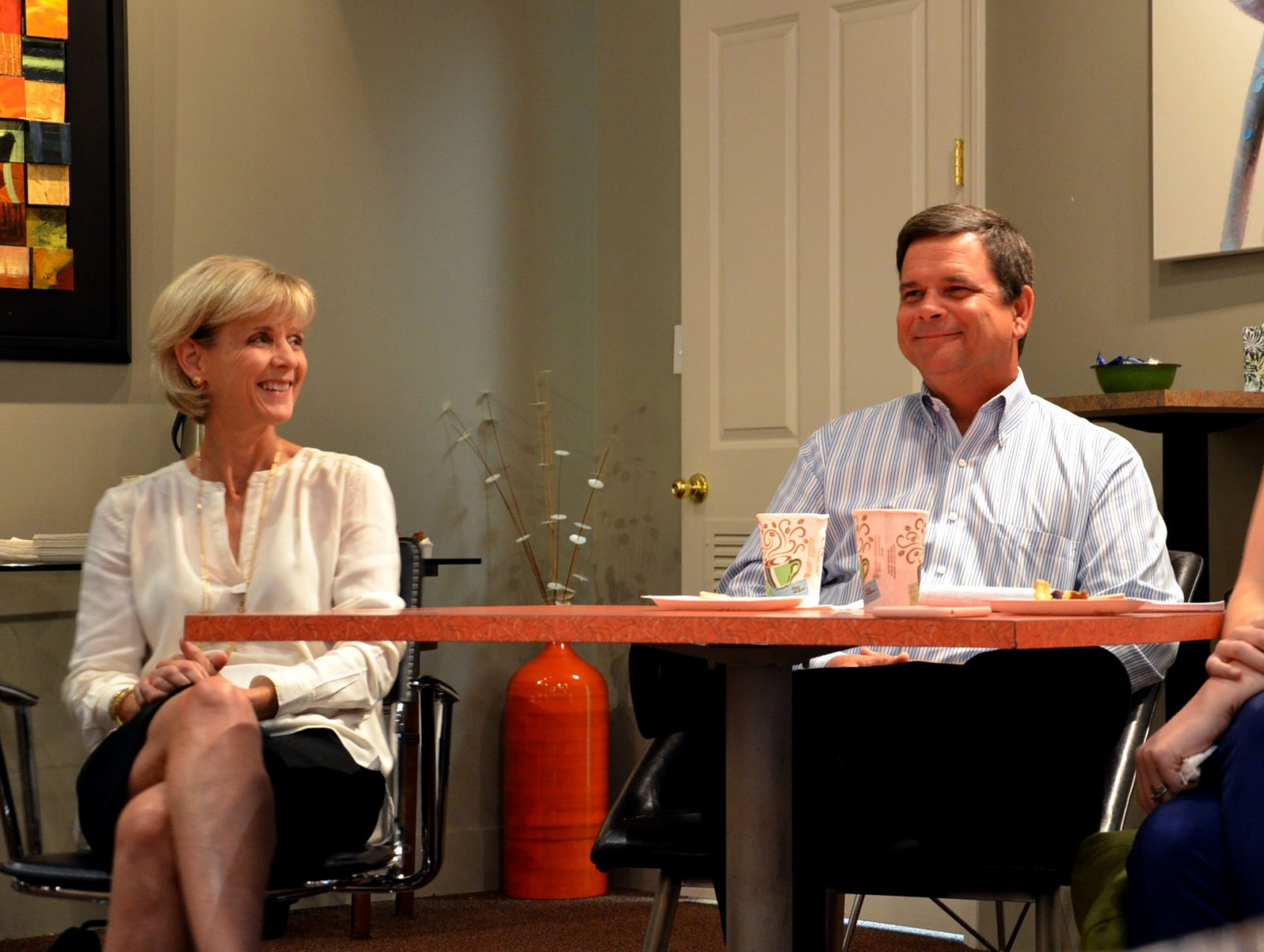 Kevin Elson, right, cautions buyers when holding discussion in the home they are looking at.