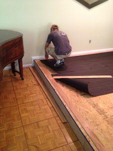 Tish Flooring installs new hardwood plank flooring beside the original oak parquet.